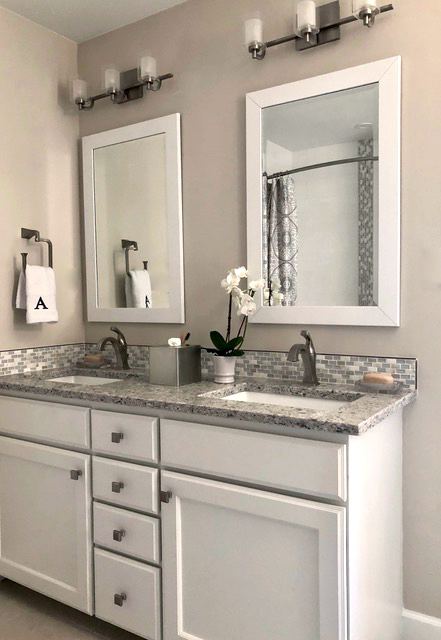 Double sink bathroom with inset sinks and neutral colors