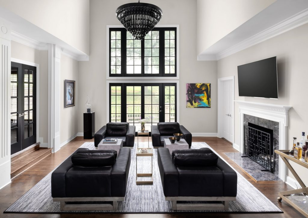 contemporary living room with black leather seating
