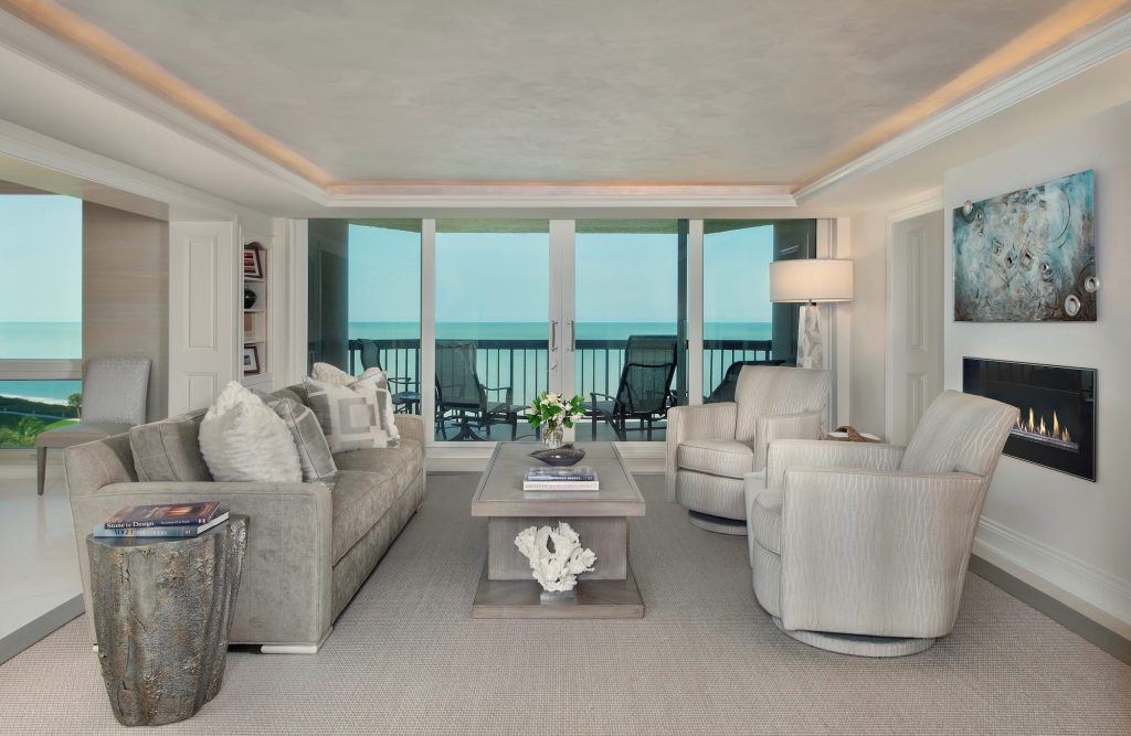 Elegant transitional living room with soft creams and aqua accented art