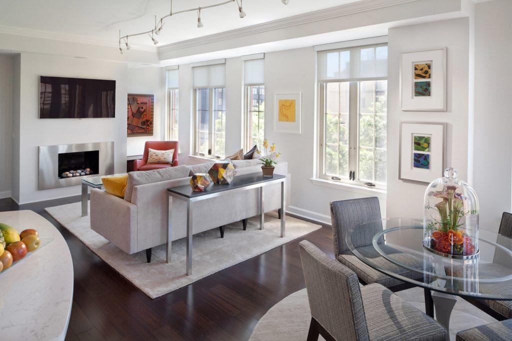Great Room condo contemporary design light fabrics dark floor floating fireplace abstract art