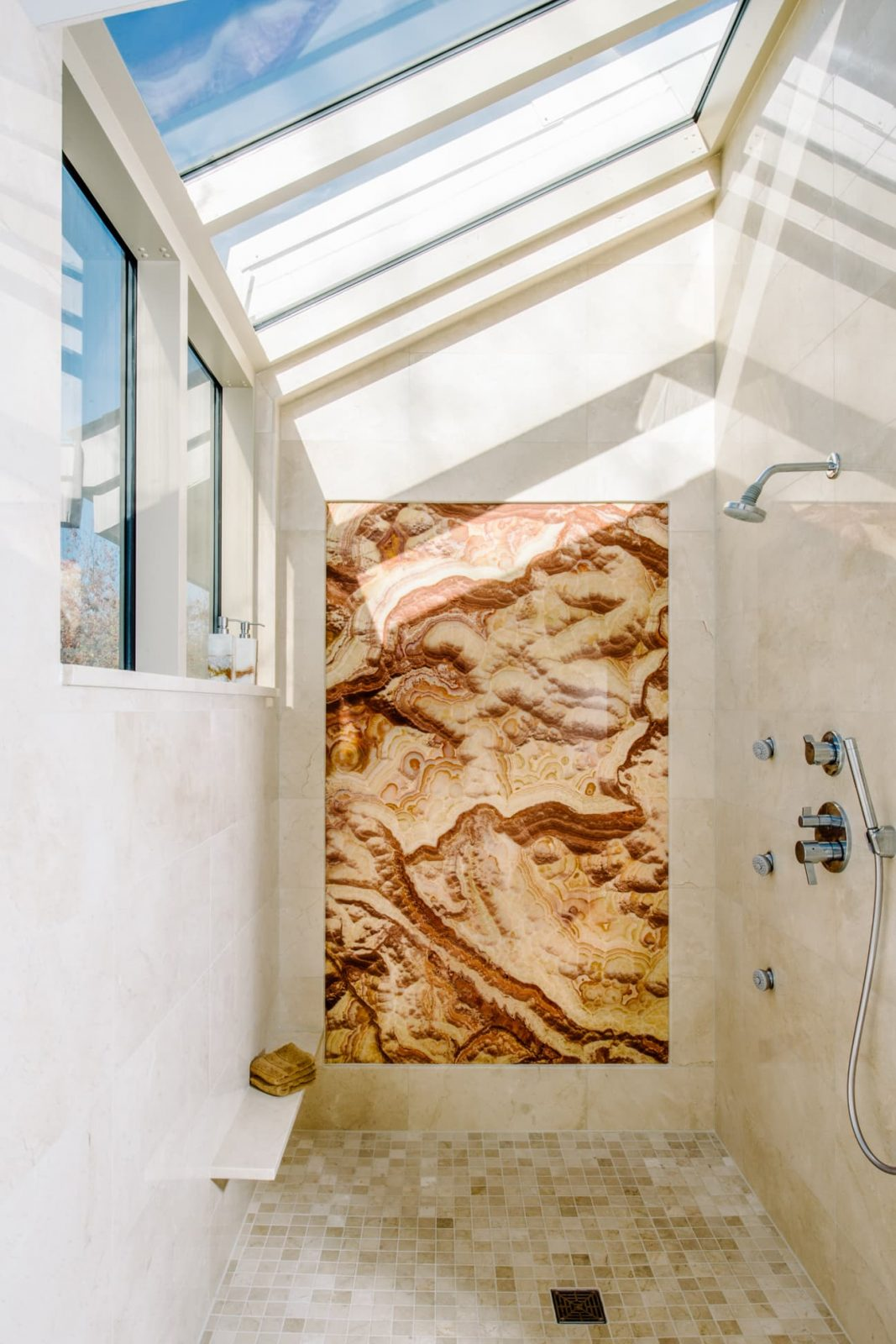 contemporary bathroom shower onyx wall with skylights and cathedral ceiling