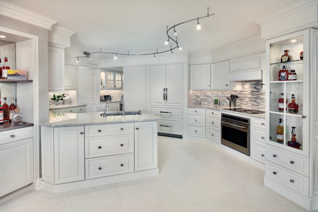 Airy and bright contemporary white kitchen with black accents and quartz counters